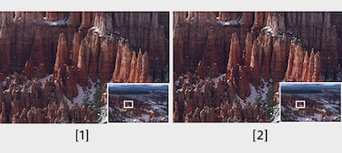 Two viewfinder images of mountainous scenery, from the Ultra-XGA OLED Tru-Finder and the Quad-VGA OLED Tru-Finder