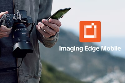 A man holing α1 and smartphone and Imaging Edge Mobile logo