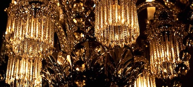 Low light image of ornate chandelier