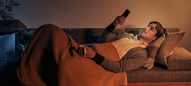 Man on sofa viewing content on Xperia 10 II