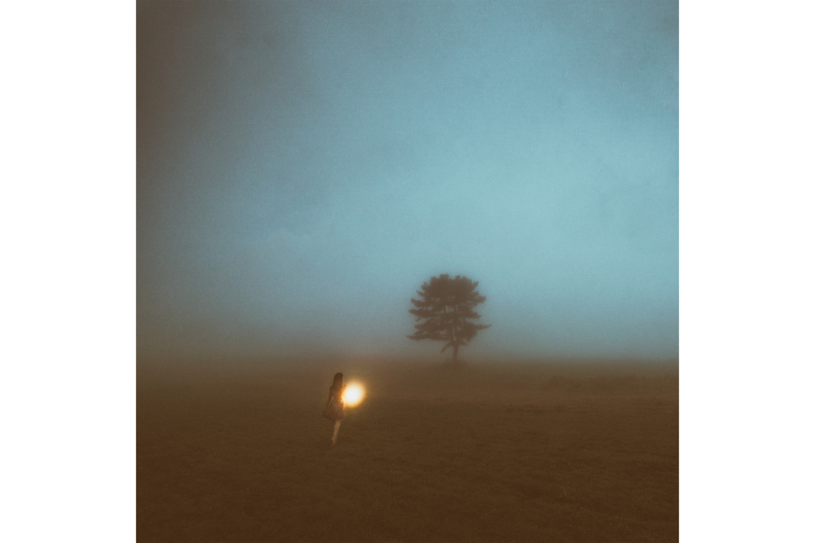 woman in foggy field alpha 9