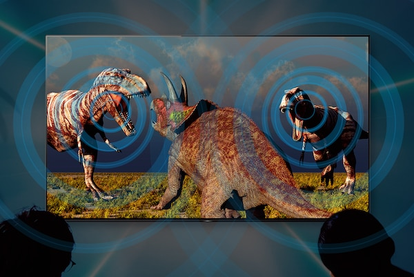Image of dinosaurs on big screen TV illustrating how sound follows the action.